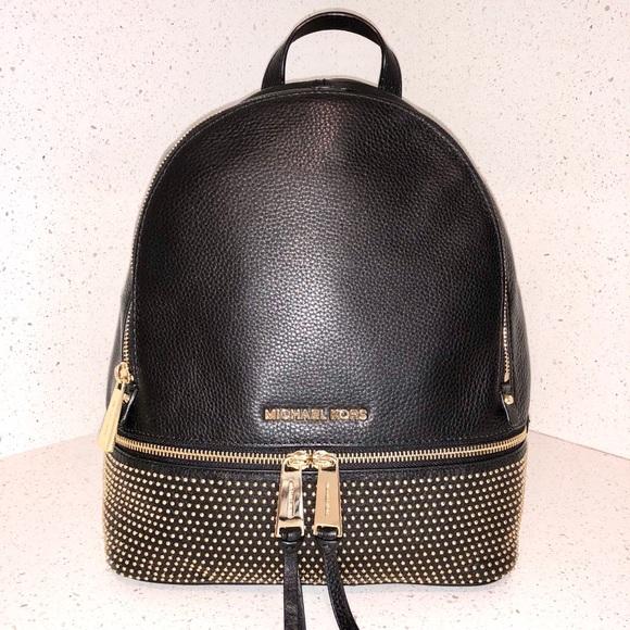 32000197cebe Michael Kors Black Leather & Gold Studded Backpack.  M_5a36ea97739d48320b020c84